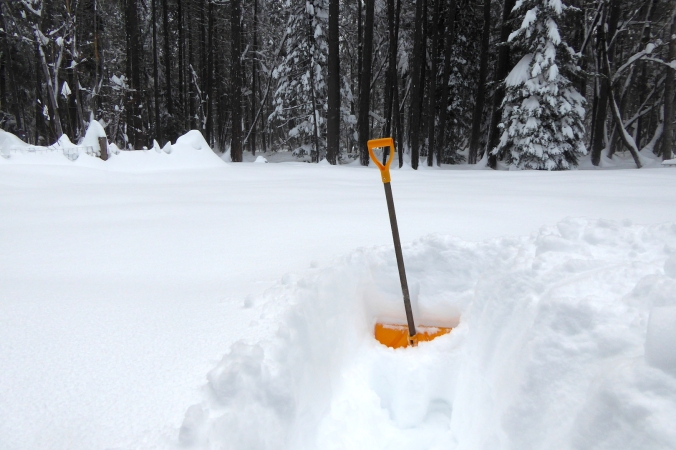 snow shovel in deep snow