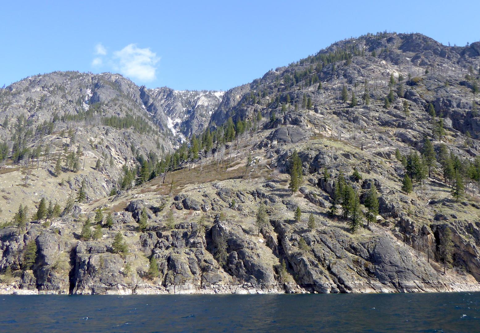 Steep mountain above lake