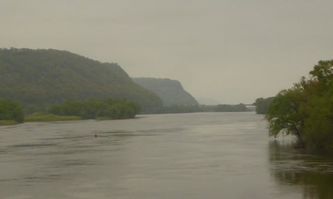 wide river with tall bluffs in background