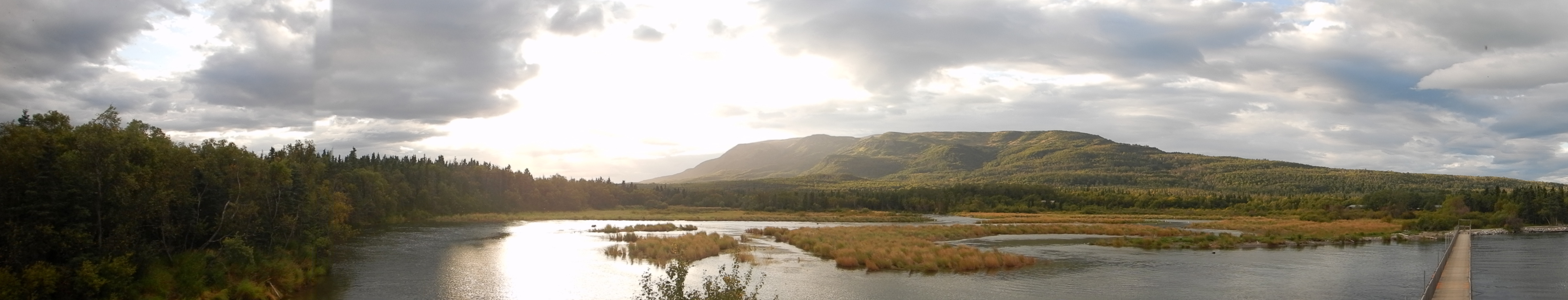 panorama of river and mountain near sunset