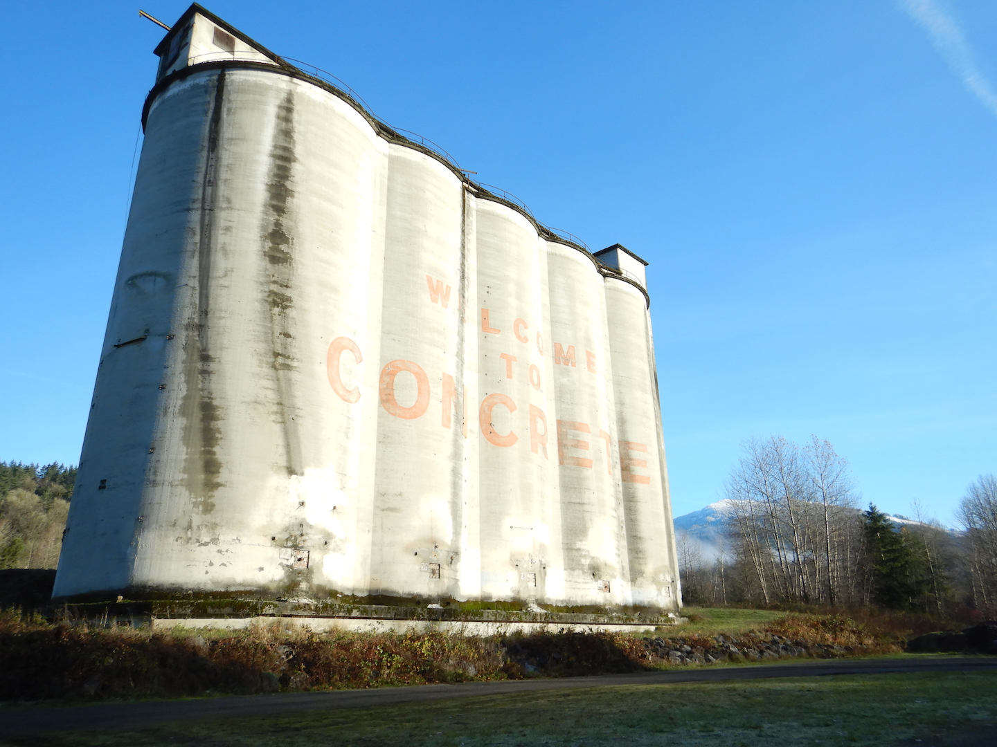Concrete silos. Text on silos reads,