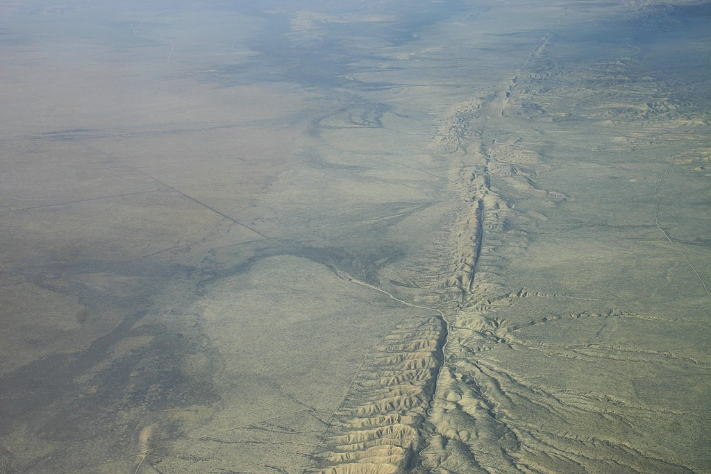 Aerial view of landscape with fault line at center right.