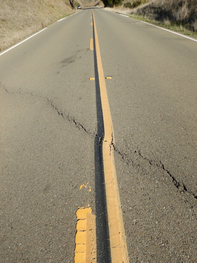 Road with crack running from middle left to lower right.