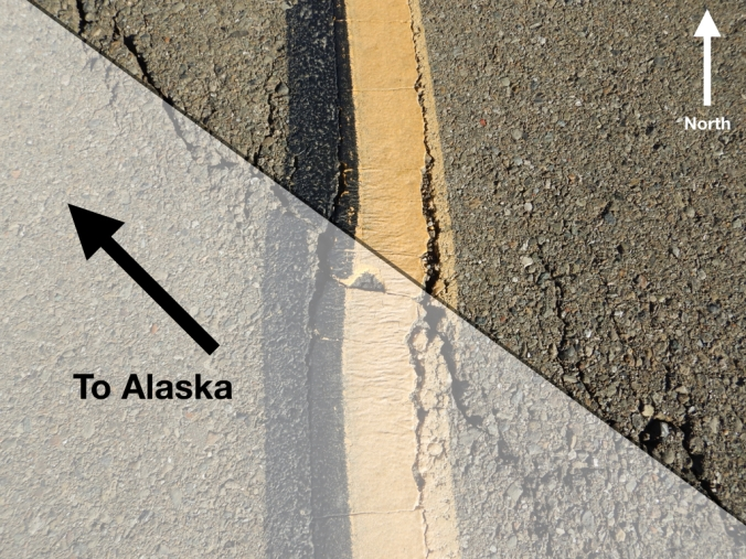 "Road pavement with crack. Text reads ""To Alaska"" and ""North"""