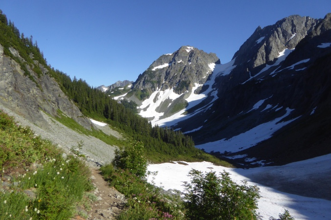 view of mountain scenery with craggy peaks and snowfields.