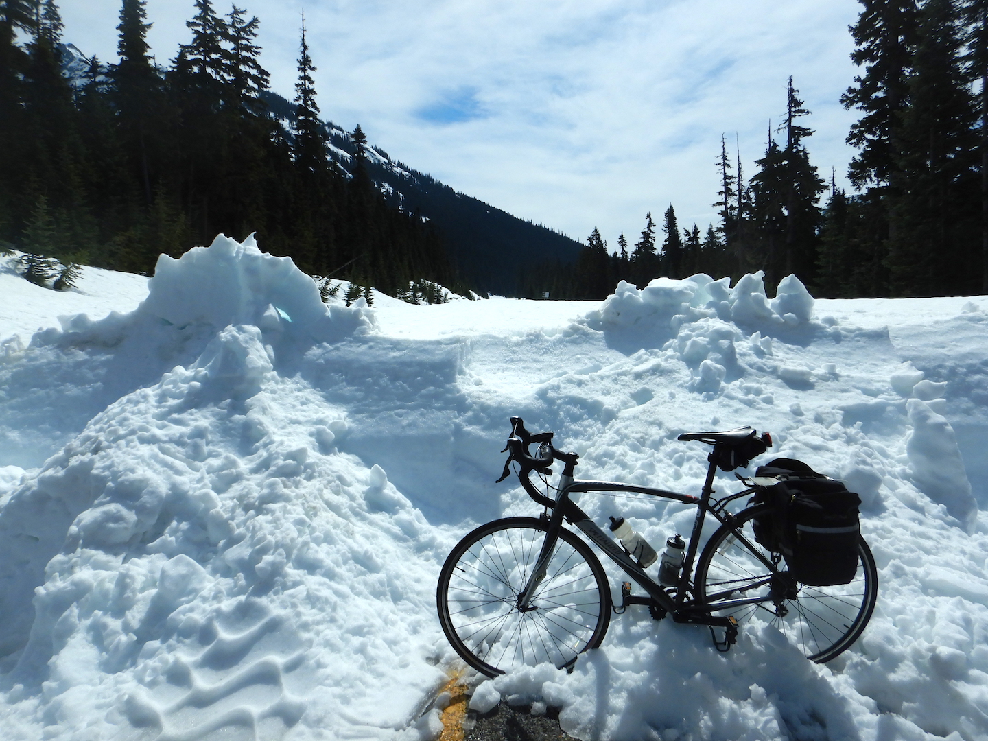 bicycle leaning on five-foot high snow bank