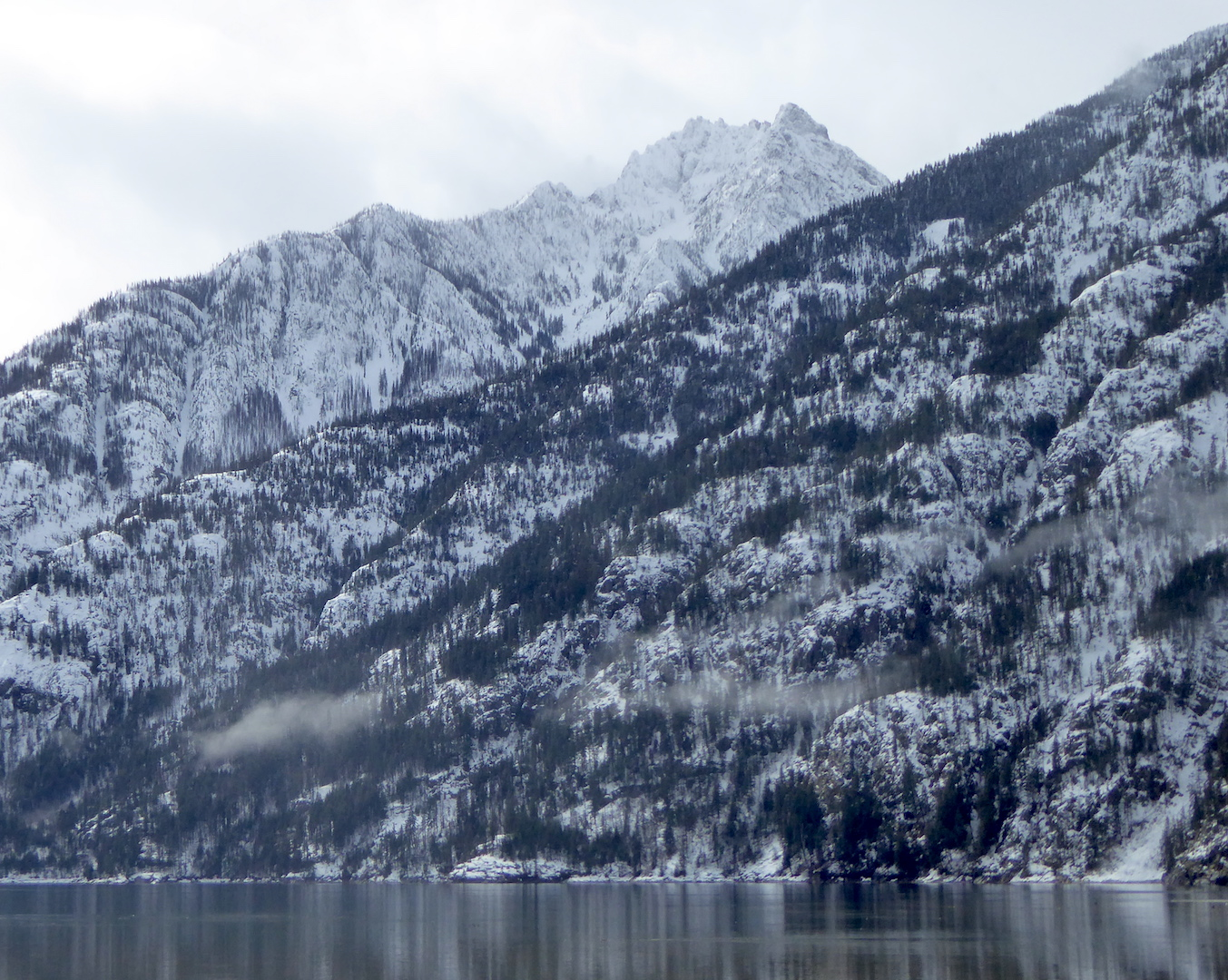 view of snowy mountains rising above lake