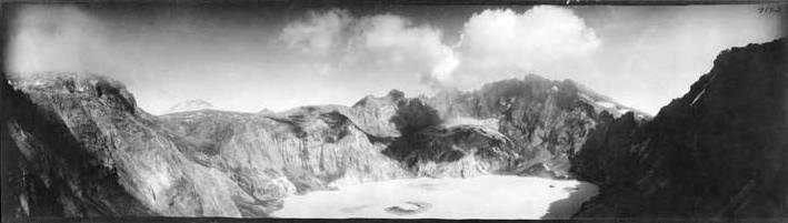 panoramic black and white photo of volcanic caldera.
