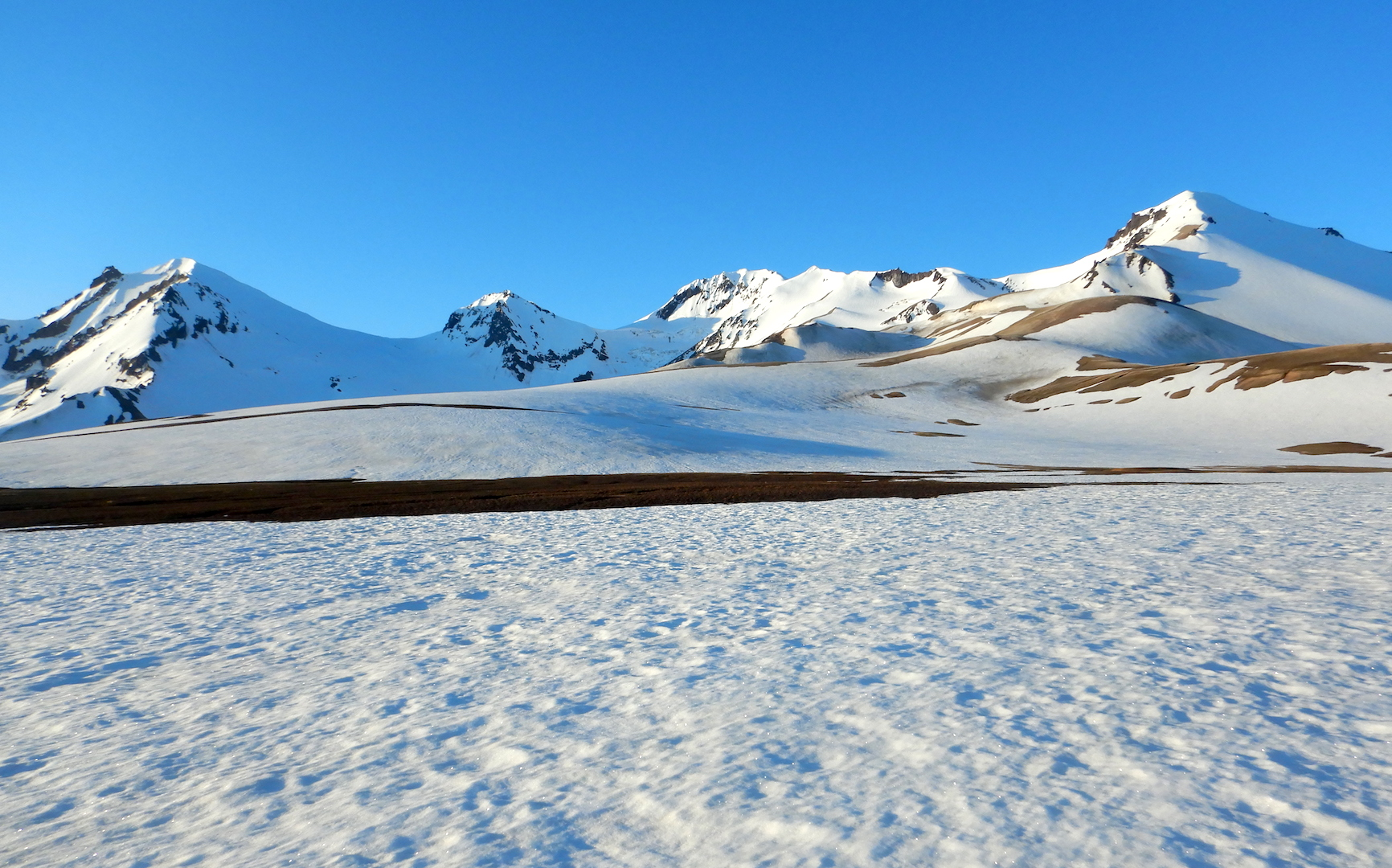 view of snowfields and mountain peaks