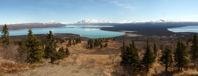 panoramic view of mountains and lakes. Snow covered mountains and volcanoes are seen on horizon