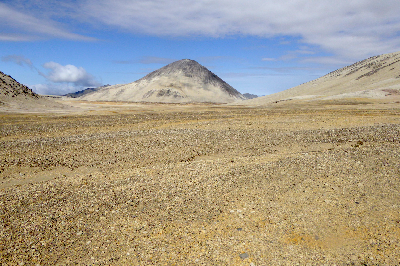ash and pumice covered plain with hills